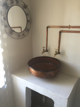 Bathroom with copper basin in Lara's Roodepoort Farm , Clarens